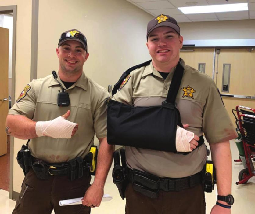 Fayette County deputies Adam Mack, left, and Ryan Meager were able to smile even after being injured in a lengthy altercation Friday morning. Fayette County Sheriff 's Offi ce photo