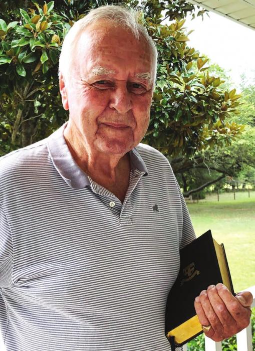 "Fayette County's Richard Dixon, who attended Christ's Hospital in England, from 1941 to 1948, holds the Bible he received upon leaving the school to go to sea. The boarding school was located in ""buzz-bomb alley,"" not far from London, which was heavily assaulted by Germany during World War II."