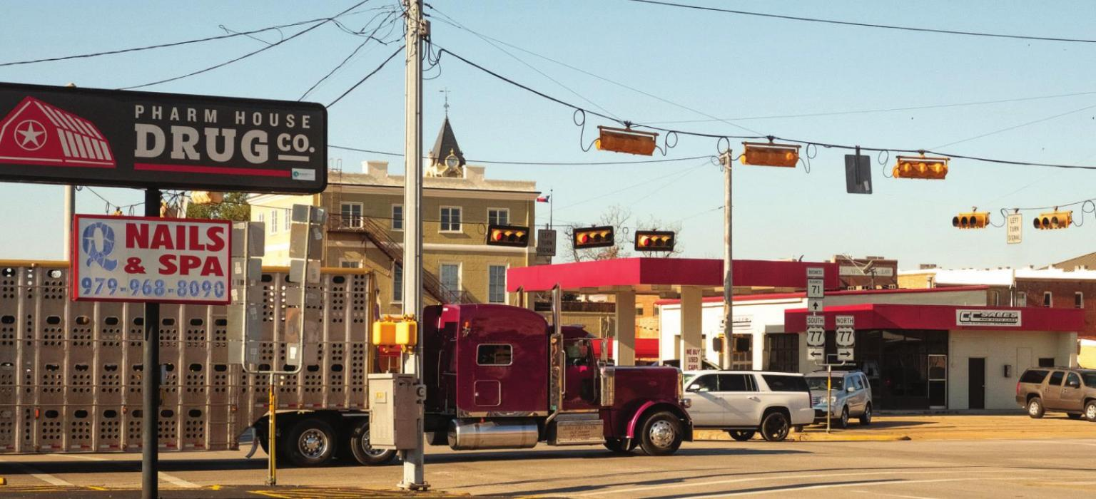 Big trucks have a hard time turning at the intersection of Travis and Jefferson (TX 71 and US 77). Texas Department of Transportation is planning to purchase property to widen the intersection. Photo by Andy Behlen