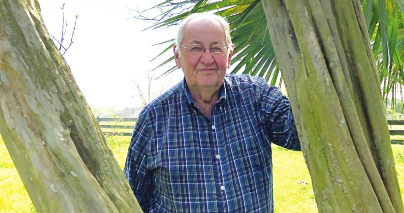 "Cordell Levien of Round Top is framed by timeworn trunks of a crepe myrtle planted by his parents nearly a century ago. In the late 1930s, Cordell recalls traveling to La Grange with his father, Alfred. When Mr. Levien stopped to see his friends in the courthouse, they asked if the youngster he had by the hand was his grandson. ""No,"" Alfred proudly told the sheriff and the judge, ""This is my youngest son, Cordell."""