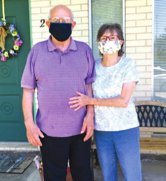 Pictured are James and Betty Miksch with a sample of the masks NVCC is making.