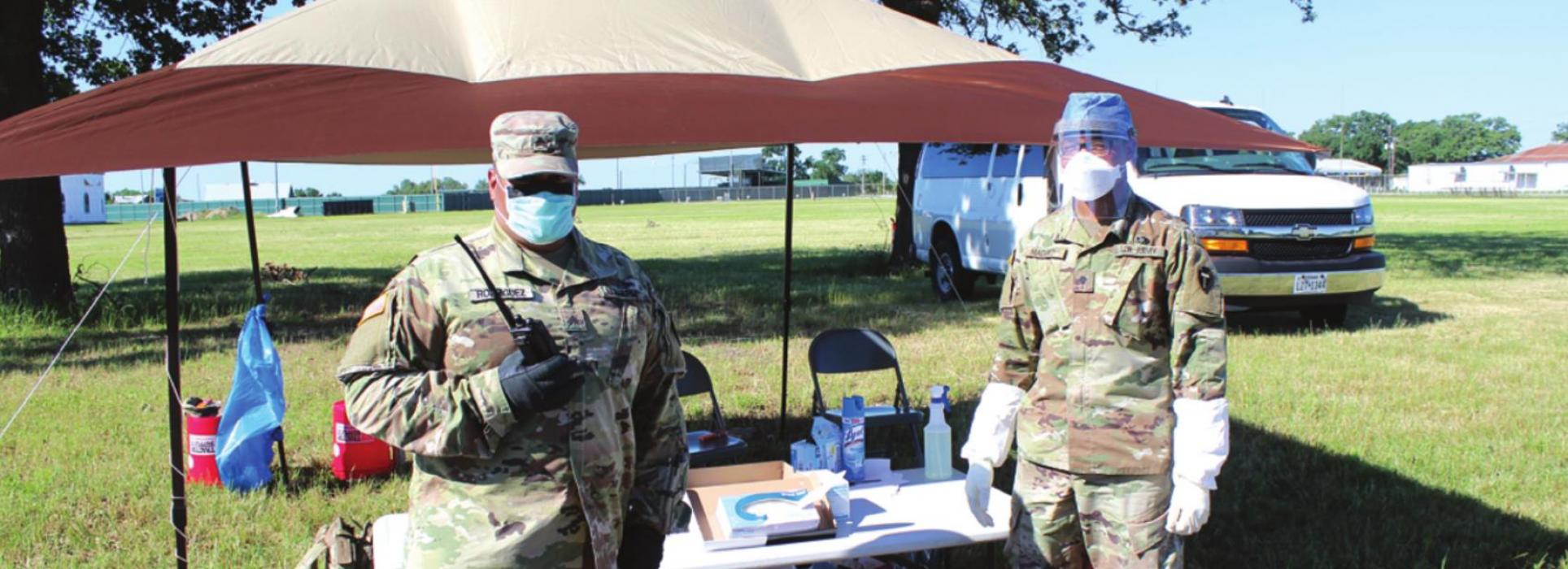 Two members of the National Guard were stationed near the entry to the fairgrounds to assist attendees at Friday's testing event. Photos by Jeff Wick