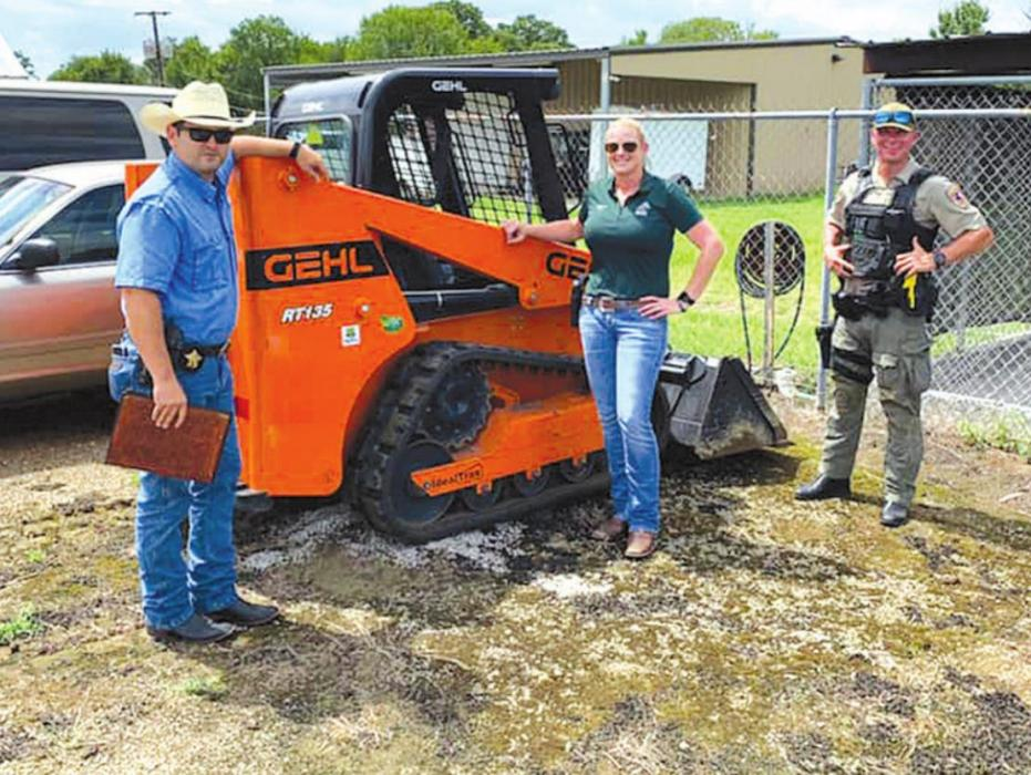 On Tuesday, the Fayette County Sheriff's Office recovered a skid steer that was stolen from a Home Depot store in Austin. Pictured are (from left) Detective Garrett Durrenberger, Sgt. Angela Lala and Interdiction Investigator David Smith. Lala was the lead investigator on the case.