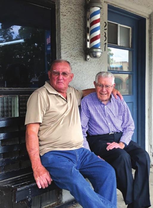 Longtime La Grange barber Ken Jurecka was joined by his friend and retired barber Charlie Ripper in late June to mark the end of an era. Combine the number of years the pair has been cutting hair, and you're looking at more than a century of barbering at its best on the courthouse square in La Grange! (Elaine Thomas shot this photo several weeks before the state and citywide masking order.)