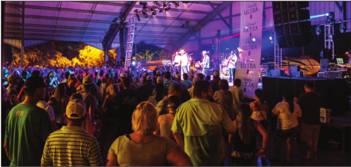 Thousands of people gathered under the Wolters Park Pavilion at last year's Schulenburg Festival to watch Diamond Rio. Photo by Andy Behlen